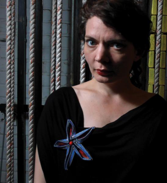 Trillian Stars, wearing a ZIgged Flower Brooch by Kate McKinnon